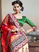 The traditional patterns used on this saree maintain the ethnic look. This red and cream net lehenga style saree have beautiful embroidery patch work which is embellished with resham, zari and stone work. Fabulous designed embroidery gives you an ethnic look and increasing your beauty. Contrasting green blouse is available. Slight Color variations are possible due to differing screen and photograph resolutions.