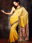 •Looks adorable in this summer sensation yellow shade saree.  •Saree features subtle floral patterns.  •Lower part of the pallu is a net patch, embellished with colorful floral thread work.  •A fancy border frames the saree.  •Faux georgette saree. •Design, Colors and patterns on the actual product may slightly vary from designs shown in the image. Images are only representative