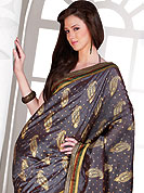 Be the cynosure of all eyes with this exquisite range of party wear sarees in flattering colors and combinations. This collection of Silk Sarees ,flaunt your feminine grace and glamour in this smart and trendy wear collection of sarees. Designer  Saree in material  with silk worked  with heavy print  work all over the saree and  embroidered lace on border. Slight Color variations possible due to differing screen and photograph resolutions.