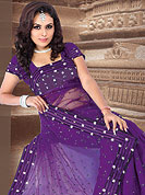 Try out this year top trends, glowing, bold and natural collection. This violet saree embellished with resham and sitara work. Border is nicely designed with sequence and stone. Pallu have also nice embroidered floral pattern. It's cool and has a very modern look to impress all. Matching blouse is available.  This saree is also available in Purple, Green, Red colors. Slight Color variations are possible due to differing screen and photograph resolutions.