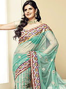 Symbol of fashion and beauty, each piece of our range of Net saree is certain to increase your look. Lehanga style Aqua green net saree have beautiful rich embroidered border. Bright red floral Border is embellished with resham, stones, and zari work. Embroidered floral butti on all over saree. This saree gives you a singular look. Slight Color variations possible due to differing screen and photograph resolutions.