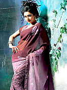 Printed saree are highly in order on a range of occasions such as casuals and formal party. This burgundy-mauve saree have stylish and amazing print work. This saree made it attractive and unique to others.  The saree is specially crafted for your stunning look and terrific style with this matching blouse. Slight Color variations are possible due to differing screen and photograph resolutions.