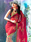 Symbol of fashion and beauty, each piece of our range of printed sarees is certain to increase your look.  It's cool and has a very modern look to impress all. This saree is embellished with leheriya print work all over the saree with floral patch on pallu. Mixing of colors make different to others. Matching blouse is available. Slight Color variations are possible due to differing screen and photograph resolutions.