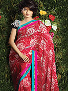 Make a remarkable fashion statement this season with this red saree. This saree embellished with abstract print work. Fabric lace on border make you attractive, unique to others. Matching blouse is available. Slight color variations are possible due to differing screen and photograph resolution.