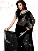 Style and trend will be at the peak of your beauty when you adorn this saree. This is a black color saree crafted on Georgette fabric. The drape and skirt is made from Silver Thread Embroidery in leaf pattern with little Sequence work. The border is also brings a contrast with it's original color by made from silver threads. Matching blouse is available. Slight Color variations are possible due to differing screen and photograph resolutions.