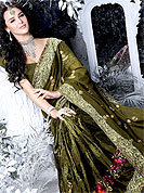 This classic shimmer dark olive green saree have fascinating embroidery floral patch and lace border on all over saree inflated with resham, sequins and zari work. This saree is specially crafted for giving you ultimate look. The matching blouse made it fabulous. Slight Color variations are possible due to differing screen and photograph resolutions.