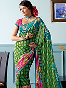 Ultimate printed saree which is surely going to make every women look gorgeous. This beautiful and pretty printed saree nicely designed with Stylish floral and check pattern. The saree is specially crafted for your stunning look and terrific style. This saree material is georgette. Matching Blouse is available. Slight color variations are possible due to differing screen and photograph resolution.