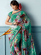 Attract all attentions with this printed saree. This beautiful and pretty printed saree nicely designed with Stylish floral pattern. The saree is specially crafted for your stunning look and terrific style. This saree material is georgette. Matching Blouse is available. Slight color variations are possible due to differing screen and photograph resolution.