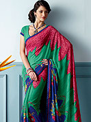 Make a remarkable fashion statement this season with this printed saree. This beautiful and pretty printed saree nicely designed with Stylish floral pattern. The saree is specially crafted for your stunning look and terrific style. This saree material is georgette. Matching Blouse is available. Slight color variations are possible due to differing screen and photograph resolution.
