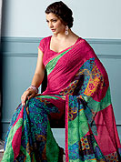 Enjoy this season with this printed saree. This beautiful and pretty printed saree nicely designed with Stylish floral pattern. The saree is specially crafted for your stunning look and terrific style. This saree material is georgette. Matching Blouse is available. Slight color variations are possible due to differing screen and photograph resolution.