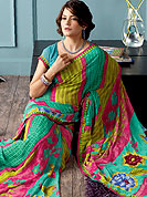 Outfit is a novel ways of getting yourself noticed. This beautiful and pretty printed saree nicely designed with Stylish strips and floral pattern. The saree is specially crafted for your stunning look and terrific style. This saree material is georgette. Matching Blouse is available. Slight color variations are possible due to differing screen and photograph resolution.