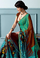 Style and trend will be at the peak of your beauty when you adorn this Printed saree. This beautiful and pretty printed saree nicely designed with Stylish floral pattern. The saree is specially crafted for your stunning look and terrific style. This saree material is georgette. Matching Blouse is available. Slight color variations are possible due to differing screen and photograph resolution.