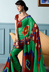 Be the cynosure of all eyes with this wonderful casual wear saree in flattering colors and combinations. This beautiful and pretty printed saree nicely designed with Stylish flower and circles pattern. The saree is specially crafted for your stunning look and terrific style. This saree material is georgette. Matching Blouse is available. Slight color variations are possible due to differing screen and photograph resolution.
