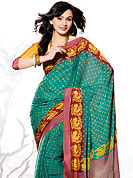 Let your personality speak for you this beautiful saree embellished with print work. This classic turquoise and red saree have fascinating printed floral and strips patterned border with dots on all over saree. Colors of this saree are nice and impress to all. This saree made with silk fabric. Matching blouse is available. Slight Color variations are possible due to differing screen and photograph resolutions.