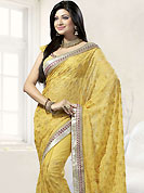 The glamorous silhouette to meet your most dire fashion needs. A gorgeous designer saree is embllished with floral embroidery and beautiful lace border. Embroidery is done with stone and resham threads. This saree is made with georgette fabric. Matching blouse is available. Slight color variations are possible due to differing screen and photograph resolutions.