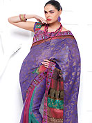 Let your personality speak for you this violet color party saree embellished with shimmer print work.  The stylish and amazing fabric patch on border made it attractive and unique to others. Attractive embroidery on pleats area gives a complete look. The saree is specially crafted for your stunning look and terrific style with this matching blouse. Slight Color variations are possible due to differing screen and photograph resolutions.