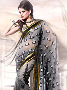 Try out this year top trends, glowing, bold and natural collection. This shaded grey faux georgette saree is beautifully encrafted with resham, zari and patch work in floral patterns. As shown blouse can be made possible and also can be customized as per your style subject to fabric limitation.  Slight color variations are possible due to differing screen and photograph resolution.