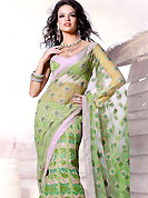 Emblem of fashion and beauty, each piece of our range of designer saree is certain to enhance your look as per today's trends. This green net lehenga style saree is beautifully adorned with resham, zari and patch work in floral patterns. As shown blouse can be made possible and also can be customized as per your style subject to fabric limitation.  Slight color variations are possible due to differing screen and photograph resolution.
