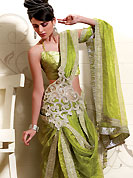 Try out this year top trends, glowing, bold and natural collection. This beautiful saree is nicely designed with rich embroidery work border in floral motifs. Embroidery is done with zari, stone, reshams and sequins work. A beautiful cutwork embroidered patch on pallu create a stunning touch. This drape is made with shimmer net fabric. Color combination of this saree is captivating and makes an impression to all. Matching blouse is available. Slight Color variations are possible due to differing screen and photograph resolutions.