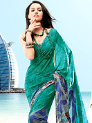 You can be sure that ethnic fashions selections of clothing are taken from the latest trend in today's fashion. This saree is nicely designed with beautiful print work in floral and abstract art pattern. Shades of saree made it attractive and unique to others. Border of saree is nicely designed with piping work. The saree is specially crafted for your stunning look and terrific style with this matching blouse. This saree made with georgette fabric. Slight Color variations are possible due to differing screen and photograph resolutions.
