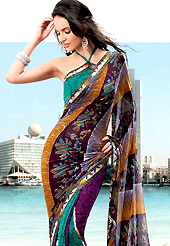 Welcome to the new era of Indian fashion wear. This saree is nicely designed with beautiful print work in floral and abstract art pattern. Shades of saree made it attractive and unique to others. Border of saree is nicely designed with piping work. The saree is specially crafted for your stunning look and terrific style with this matching blouse. This saree made with georgette fabric. Slight Color variations are possible due to differing screen and photograph resolutions.