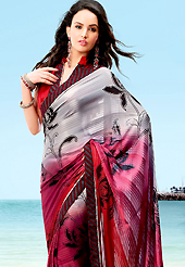 Look stunning rich with dark shades and floral patterns. This saree is nicely designed with beautiful print work in floral and strips pattern. Shades of saree made it attractive and unique to others. Border of saree is nicely designed with piping work. The saree is specially crafted for your stunning look and terrific style with this matching blouse. This saree made with georgette fabric. Slight Color variations are possible due to differing screen and photograph resolutions.