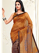 It is color this season and bright shaded suits are really something that is totally in vogue. This orange and violet net printed casual wear saree have floral print patch on pallu and lines print on all over the saree. Border has amazing contrasting fabric lace. It's cool and has a very modern look to impress all. Matching blouse is available.  Slight Color variations are possible due to differing screen and photograph resolutions.