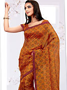 Breathtaking collection of sarees with stylish print work and fabulous style. This orange net printed casual wear saree have floral butti print on all over the saree. Border has amazing contrasting fabric lace. It's cool and has a very modern look to impress all. Matching blouse is available.  Slight Color variations are possible due to differing screen and photograph resolutions.