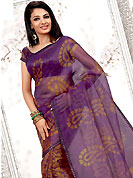Different colors are a perfect blend of traditional Indian heritage and contemporary artwork. This purple and orange net printed casual wear saree have floral print on all over and paisley print on pallu. Border has amazing contrasting fabric lace. It's cool and has a very modern look to impress all. Matching blouse is available.  Slight Color variations are possible due to differing screen and photograph resolutions.