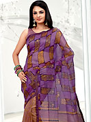 The popularity of this dress comes from the fact that it showcases the beauty modesty as well as exquisitely. This violet and yellow net printed casual wear saree have beautiful floral and block print work on all over. Border has amazing contrasting fabric lace. It's cool and has a very modern look to impress all. Matching blouse is available.  Slight Color variations are possible due to differing screen and photograph resolutions.