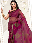 You can be sure that ethnic fashions selections of clothing are taken from the latest trend in today's fashion. This pink net printed casual wear saree have beautiful floral and geometrical art print work on all over. Border has amazing contrasting fabric lace. It's cool and has a very modern look to impress all. Matching blouse is available.  Slight Color variations are possible due to differing screen and photograph resolutions.