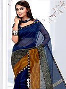 Attract all attentions with this printed saree. This blue net printed casual wear saree have beautiful geometrical art print work on all over. Border has amazing contrasting fabric lace. It's cool and has a very modern look to impress all. Matching blouse is available.  Slight Color variations are possible due to differing screen and photograph resolutions.