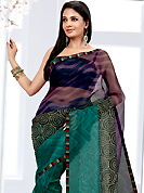 Attract all attentions with this printed saree. This light blue net printed casual wear saree have beautiful geometrical art print work on all over. Border has amazing contrasting fabric lace. It's cool and has a very modern look to impress all. Matching blouse is available.  Slight Color variations are possible due to differing screen and photograph resolutions.
