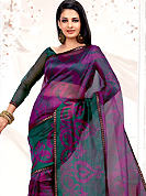 Emblem of fashion and beauty, each piece of our range of printed saree is certain to enhance your look as per today's trends. This Purple net printed casual wear saree have beautiful urban floral print work on all over. Border has amazing contrasting fabric lace. It's cool and has a very modern look to impress all. Matching blouse is available.  Slight Color variations are possible due to differing screen and photograph resolutions.