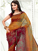 Take the fashion industry by storm in this beautiful printed saree. This red and orange net printed casual wear saree have beautiful floral and dots print work on all over. Border has amazing contrasting fabric lace. It's cool and has a very modern look to impress all. Matching blouse is available.  Slight Color variations are possible due to differing screen and photograph resolutions.
