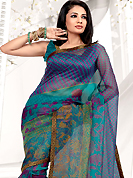 Take the fashion industry by storm in this beautiful printed saree. This light blue net printed casual wear saree have beautiful floral, paisley and dots print work on all over. Border has amazing contrasting fabric lace. It's cool and has a very modern look to impress all. Matching blouse is available.  Slight Color variations are possible due to differing screen and photograph resolutions.
