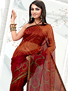 Let your personality articulate for you with this amazing printed saree. This red and orange net printed casual wear saree have beautiful abstract and geometrical art print work on all over. Border has amazing contrasting fabric lace. It's cool and has a very modern look to impress all. Matching blouse is available.  Slight Color variations are possible due to differing screen and photograph resolutions.