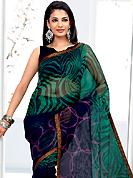 Let your personality articulate for you with this amazing printed saree. This dark blue and turquoise green net printed casual wear saree have beautiful abstract and geometrical art print work on all over. Border has amazing contrasting fabric lace. It's cool and has a very modern look to impress all. Matching blouse is available.  Slight Color variations are possible due to differing screen and photograph resolutions.