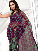 Style and trend will be at the peak of your beauty when you adorn this saree. This purple and pastel green net printed casual wear saree have beautiful floral and polka dots print work on all over. Border has amazing contrasting fabric lace. It's cool and has a very modern look to impress all. Matching blouse is available.  Slight Color variations are possible due to differing screen and photograph resolutions.