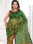 Style and trend will be at the peak of your beauty when you adorn this saree. This yellow and green net printed casual wear saree have beautiful floral and polka dots print work on all over. Border has amazing contrasting fabric lace. It's cool and has a very modern look to impress all. Matching blouse is available.  Slight Color variations are possible due to differing screen and photograph resolutions.