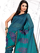 Elegance and innovation of designs crafted for you. This light blue net printed casual wear saree have beautiful floral butta and lines print work on all over. Border has amazing contrasting fabric lace. It's cool and has a very modern look to impress all. Matching blouse is available.  Slight Color variations are possible due to differing screen and photograph resolutions.