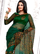 Envelope yourself in classic look with this charming saree. This green net printed casual wear saree have beautiful floral print work on all over. Border has amazing contrasting fabric lace. It's cool and has a very modern look to impress all. Matching blouse is available.  Slight Color variations are possible due to differing screen and photograph resolutions.