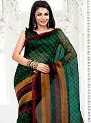 This season dazzle and shine in pure colors. This green net printed casual wear saree have beautiful polka dots print work on all over. Border has amazing contrasting strips in swirls print work. It's cool and has a very modern look to impress all. Matching blouse is available.  Slight Color variations are possible due to differing screen and photograph resolutions.