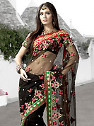 Bold colors created by the inventive drapes of textile catch the imagination like no other contemporary clothing. Black Net Saree is crafted with resham, zari and stone worked embroidery butti on all over with graceful border. Saree have an impressive color combination which gives a cultural look rising beauty of saree. Matching Blouse is available with this saree. Slight Color variations are possible due to differing screen and photograph resolutions.