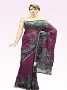 Heavy stone work saree with two shaded blue and gray golden pearl work on all over border