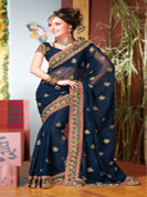 designer georgette saari with embroidery work and embroidery on border with pallu border.