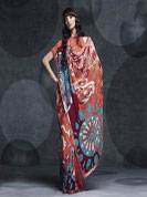 Make you pleasing Faux georgette saree. Flaky rust color with traditional chic prints. With Bottom lace work.