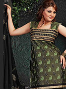 Motivate your look with this sap green suit. This Polyester net suit adorns with embroidery work. Beautiful leaves done with dhaga embroidery and grave lace on kameez which is enhanced your personality. Stylish pattern on neck is stunning. Matching churidar and embellished dupatta is available with this. Slight Color variations are possible due to differing screen and photograph resolutions.