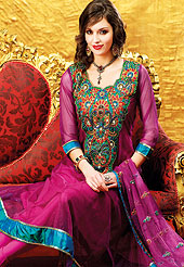 Motivate your look with this purple suit. This amazing suit adorns with embroidery work. Neck is nicely designed with huge floral pattern patch work done with resham threads. Satin lace border on kameez which is enhanced your personality. Butti work on dupatta is stunning and stylish. Matching churidar and embellished dupatta is available with this. Slight Color variations are possible due to differing screen and photograph resolutions.