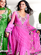 Era with extension in fashion, style, Grace and elegance have developed grand love affair with this ethnical wear. This Gorgeous anarkali pink suit embellished with Swarovski, red and green stone with beautiful sequins of silver chain and parsec border. This drape material is net with brocade inner. Matching salwaar and dupatta is available. Slight color variations are possible due to differing screen and photograph resolutions.